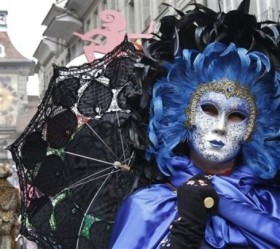 Masked people take part at  a carnival parade in Bern, Switzerland Saturday March 12, 2011. (AP Photo/Keystone/Peter Klaunzer)
