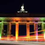 Cars drive past the Brandenburg Gate in Berlin, Germany, 18 October 2012. Buildings in Berlin are illuminated during the Festival of Lights until 20 October 2012. PHoto: Rainer Jensen (pictured with long-time exposure)